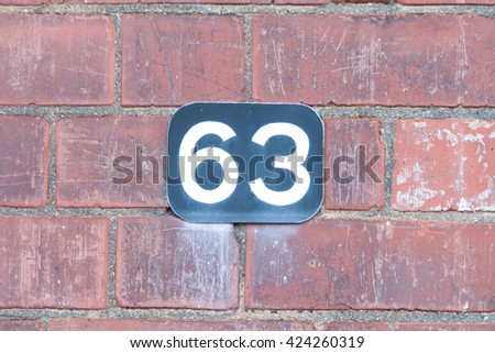 House number 63 sign