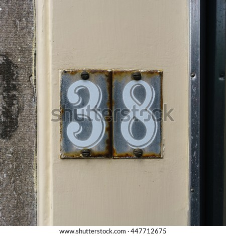 house number thirty eight - stock photo