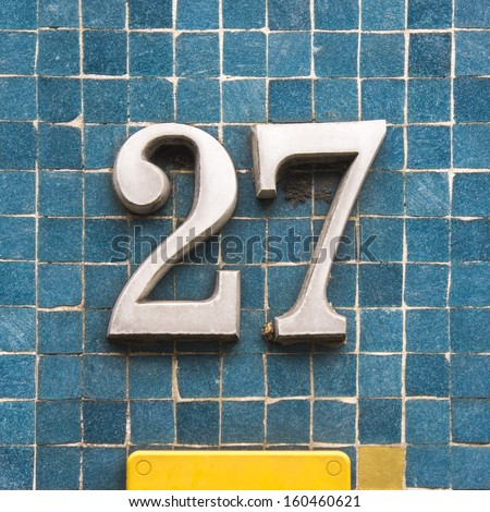House number twenty seven made out of cast iron - stock photo