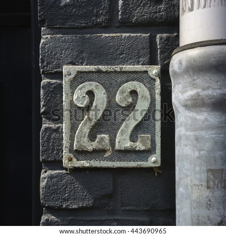 house number twenty two made out of cast metal - stock photo