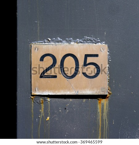 House number two hundred and five engraved in a copper plate - stock photo