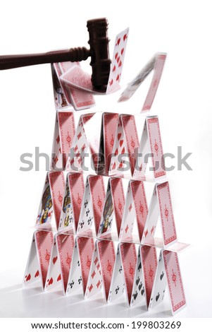 House of cards destroyed by hammer - stock photo