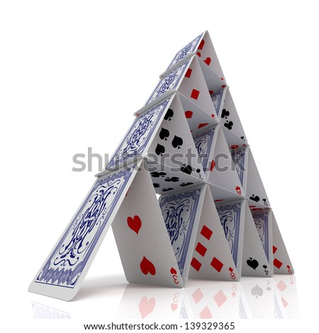 House of cards over a glossy white surface - stock photo