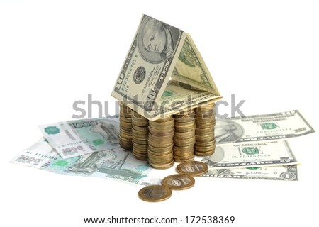 House of coins and banknotes isolated - stock photo