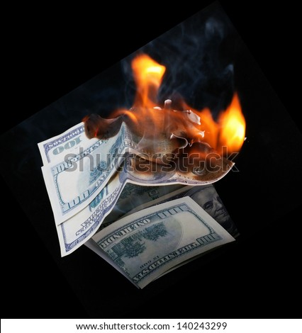 House of Dollar burns brightly. fire - stock photo
