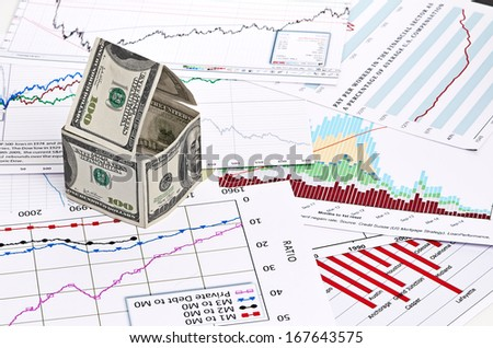 House of dollars. on chart background - stock photo