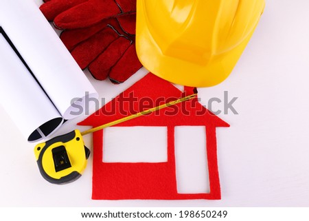 House of felt with helmet and gloves isolated on white - stock photo