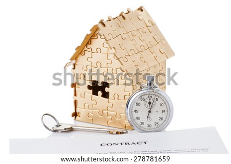 house of gold color with a stopwatch and a contract isolated on white background. Concept: time to buy a house - stock photo