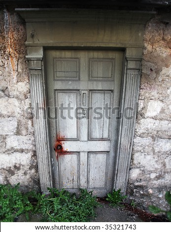 House of Horror concept, creepy weathered Door with blood stained doorknob and entrance, Wide angle lens used for added distortion - stock photo