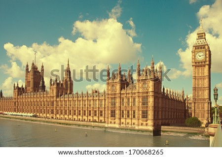 House of Parliament with Big Ben tower in London UK view from Themes river. Toned image - stock photo