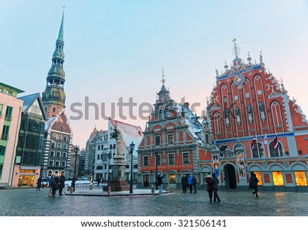 House of the Blackheads, sculpture of Saint Roland and Saint Peters Church - the main treasures of Old Riga at a winter day. Latvia, Europe - stock photo