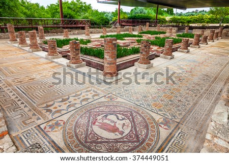 House of the Fountains in Conimbriga. View of the very ornate mosaics, peristyle, garden and pond. Conimbriga in Portugal, is one of the best preserved Roman cities on the west of the empire. - stock photo