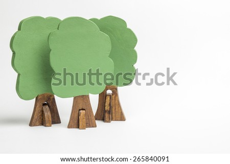 House of wooden blocks of different colors, three wooden figures of trees, euro money, three models of cars, keychains - stock photo