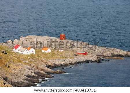 House on a peninsula by the sea - stock photo
