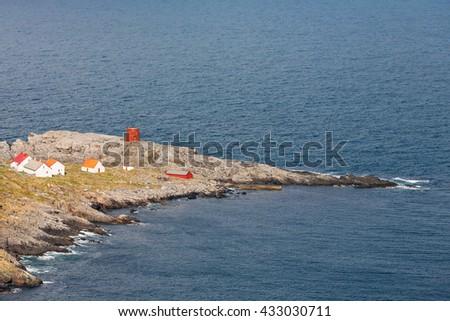 House on a peninsula on the rocky coast - stock photo