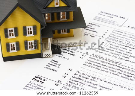 House on a US tax form schedule A - stock photo