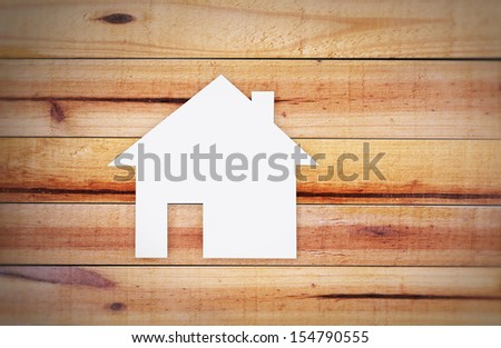 house on a wood background - stock photo