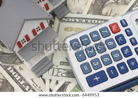 House on American currency and calculator