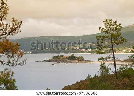 House on an island, in Galicia. - stock photo