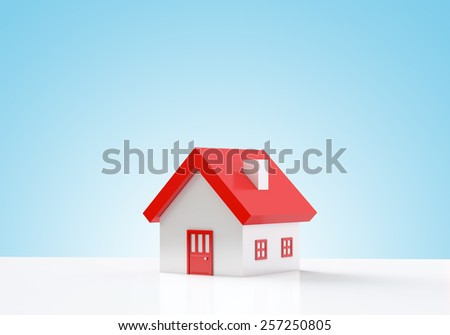 House on blue background with copy space - stock photo
