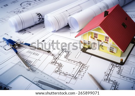 house on blueprints - housing project  - stock photo