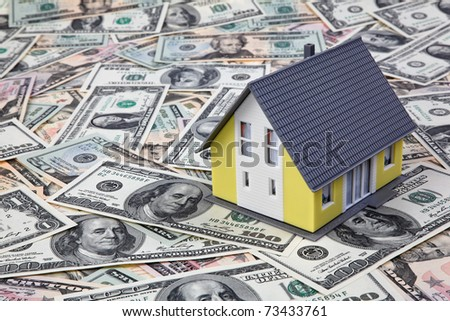 House on dollar bills. Housing crisis in America. - stock photo