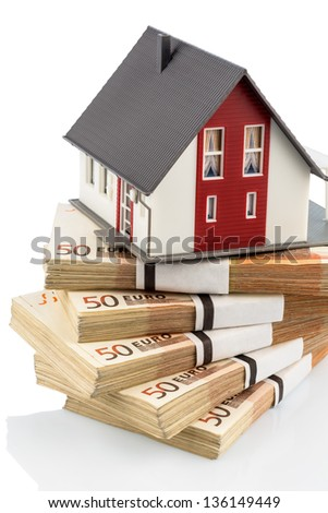 house on euro banknotes, symbolic photo for home purchase, financing, building society - stock photo