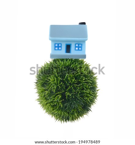 house on  glass Globe of the earth - stock photo