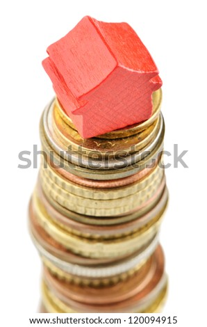 House on gold coins increasing in value - stock photo