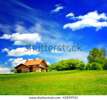 House on green hill - stock photo