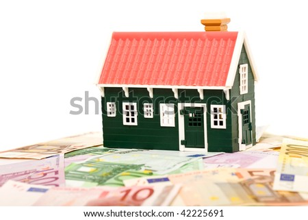 House on money field or foundation - finance concept, isolated