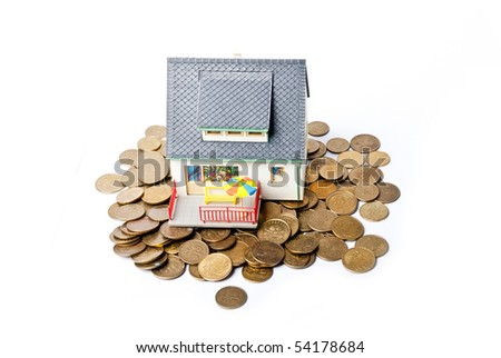 house on pile of coins - stock photo