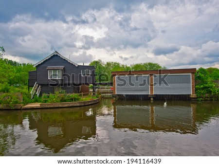 house on river - stock photo