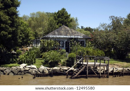 House on river side - stock photo