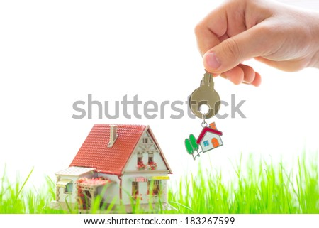 House on spring green grass. Real estate concept - stock photo