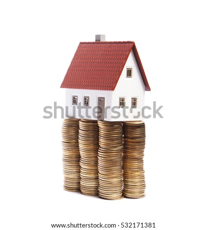 House on stacks of coins