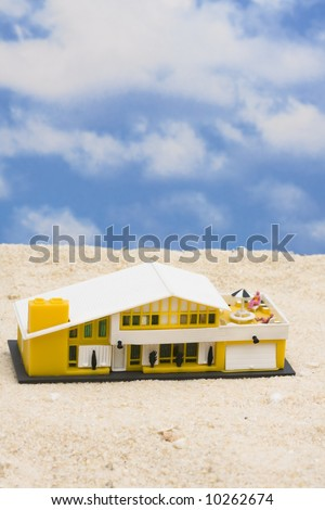 House on the beach with copy space - stock photo