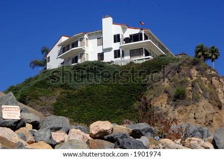 House on the cliff. - stock photo