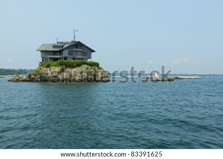 House on the small rocky island in the Newport Harbor, Rhode Island, USA. - stock photo