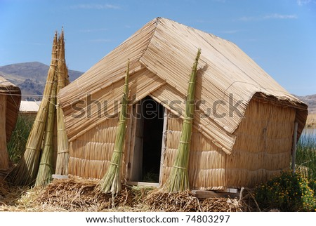 House on Uros island Titicaca lake - stock photo