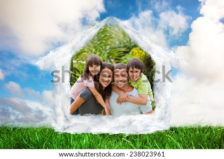 House outline in clouds against cityscape on the horizon - stock photo