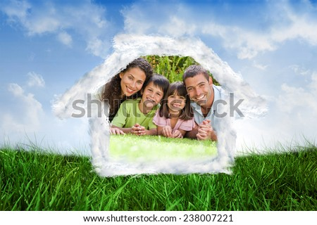 House outline in clouds against field of grass under blue sky - stock photo