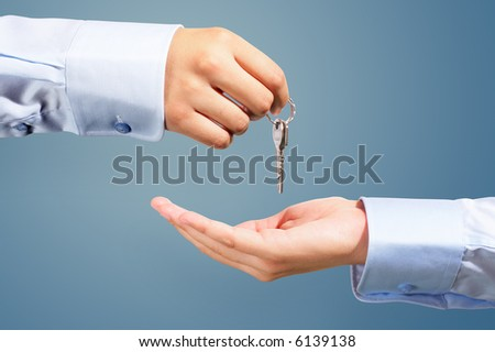House owner/real estate agent giving away the keys - stock photo