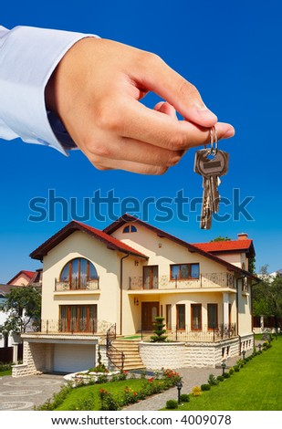 House owner/real estate agent giving away the keys - everything in focus - stock photo
