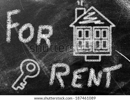 House painted on chalkboard - stock photo