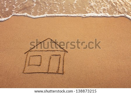 house painted on the beach - stock photo