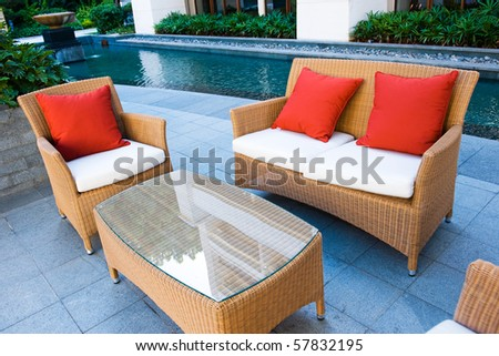 House patio with tables, chairs and pool. - stock photo