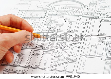 House plan blueprints, designer's hand - stock photo
