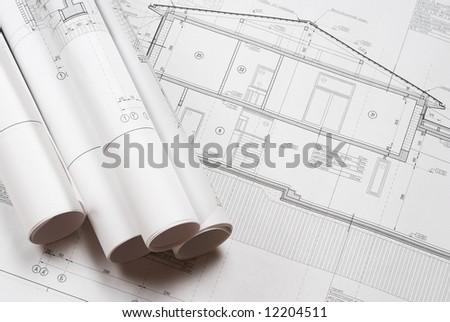 House plan blueprints roled up - stock photo