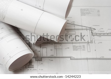 House plan blueprints roled up - stock photo